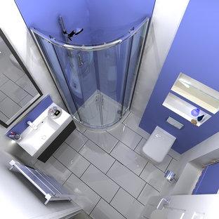 Immagine di una stanza da bagno padronale design con lavabo sospeso, doccia ad angolo, WC sospeso, pareti viola e pavimento in gres porcellanato