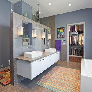 Bathroom - contemporary bathroom idea in Houston with a wall-mount toilet