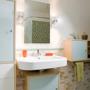 Example of a small trendy master beige tile, green tile, white tile and subway tile travertine floor bathroom design in Los Angeles with glass-front cabinets, white cabinets, a one-piece toilet, white walls and a wall-mount sink