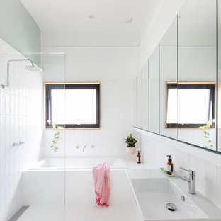 Contemporary master wet room bathroom in Perth with open cabinets, white cabinets, a drop-in tub, white tile, green walls, a wall-mount sink, white floor, an open shower and white benchtops.