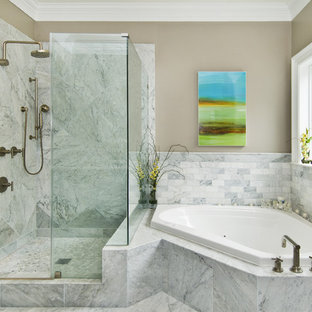 Inspiration for a transitional stone tile corner bathtub remodel in San Francisco