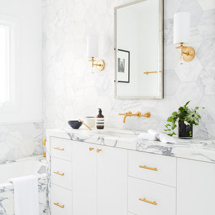 Contemporary bathroom in San Francisco with flat-panel cabinets, white cabinets, a submerged bath, multi-coloured tiles, white walls, a submerged sink, marble tiles and marble worktops.