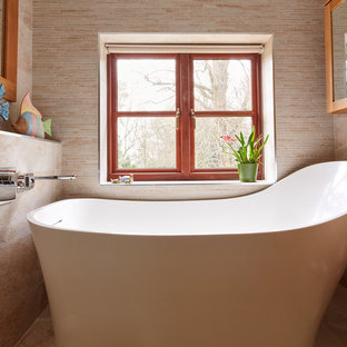 This is an example of a small bathroom in Hertfordshire with a freestanding bath, a walk-in shower and a wall mounted toilet.