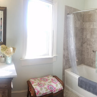 Inspiration for a small master gray tile and porcelain tile vinyl floor and gray floor bathroom remodel in Other with furniture-like cabinets, medium tone wood cabinets, a two-piece toilet, gray walls, an undermount sink, engineered quartz countertops and white countertops