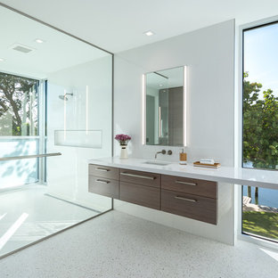 Example of a huge minimalist master white tile walk-in shower design in Tampa with flat-panel cabinets, a wall-mount toilet, white walls, dark wood cabinets and an undermount sink