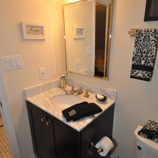 Inspiration for a mid-sized modern master bathroom remodel in DC Metro with an undermount sink, black cabinets and marble countertops