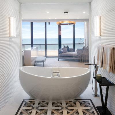 Freestanding bathtub - contemporary white tile beige floor freestanding bathtub idea in Tampa