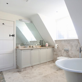 Inspiration for a transitional beige tile and ceramic tile bathroom remodel in London with an undermount