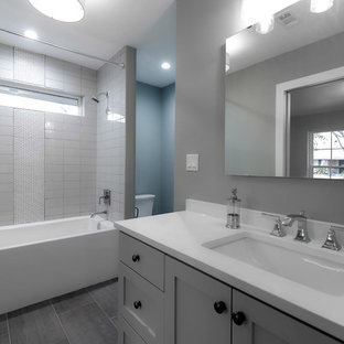 Alcove shower - small transitional kids' porcelain tile alcove shower idea in Dallas with shaker cabinets and white cabinets