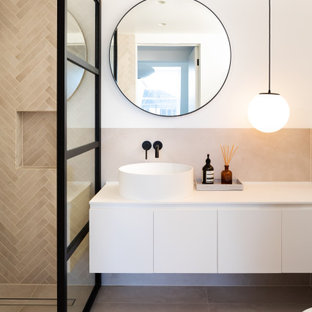 Photo of a medium sized contemporary shower room bathroom in London with flat-panel cabinets, white cabinets, an alcove shower, beige tiles, white walls, a vessel sink, beige floors, an open shower and white worktops.