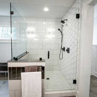 Idée de décoration pour une salle de bain principale style shabby chic de taille moyenne avec un placard en trompe-l'oeil, des portes de placard en bois sombre, une douche double, un carrelage blanc, des carreaux de porcelaine, un mur blanc, un sol en carrelage de porcelaine, un lavabo encastré, un plan de toilette en quartz, un sol gris, une cabine de douche à porte battante et un plan de toilette gris.