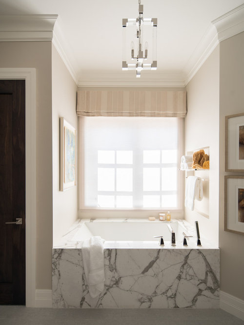 bathroom photo in denver with an undermount tub beige walls and gray floors