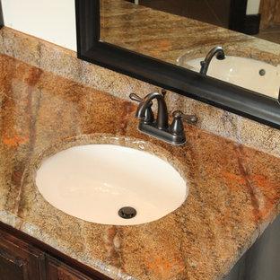 Elegant master concrete floor and brown floor bathroom photo in Dallas with concrete countertops