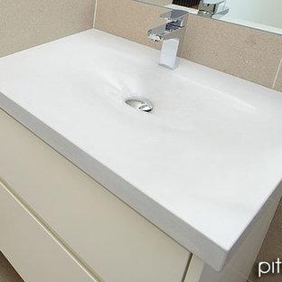Immagine di una stanza da bagno minimal con lavabo integrato e top in cemento