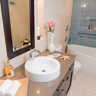 Example of a transitional bathroom design in Other with a console sink
