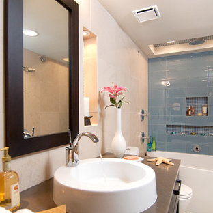 Inspiration for a transitional blue tile and glass tile bathroom remodel in Other with a console sink