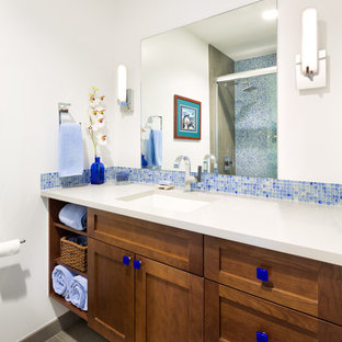 Inspiration for a transitional 3/4 blue tile and mosaic tile alcove shower remodel in Denver with shaker cabinets, medium tone wood cabinets and an undermount sink