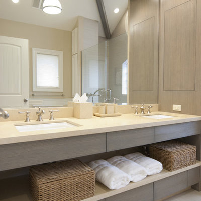 Mid-sized trendy master bathroom photo in New York with an undermount sink, gray cabinets and limestone countertops