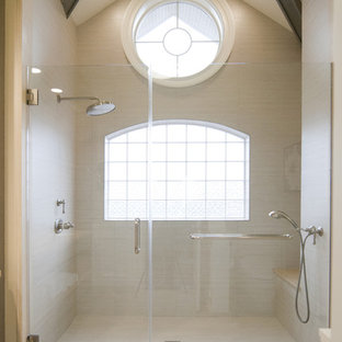 Example of a trendy beige tile alcove shower design in New York