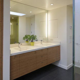 Inspiration for a contemporary gray tile bathroom remodel in San Francisco with an integrated sink, flat-panel cabinets, medium tone wood cabinets and white walls