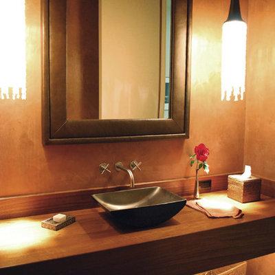 Bathroom - contemporary bathroom idea in San Francisco with a vessel sink and wood countertops