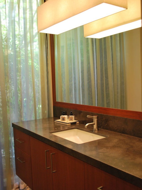 trendy bathroom photo in san francisco with an undermount sink flatpanel cabinets and
