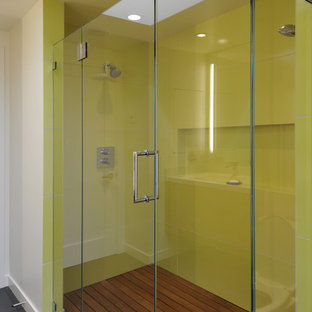 Design ideas for a contemporary bathroom in San Francisco with an alcove shower, gray tile and green walls.