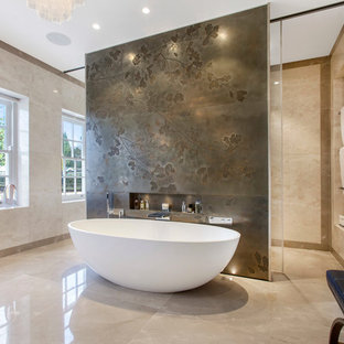 Photo of a contemporary bathroom in London with a freestanding bath and beige walls.