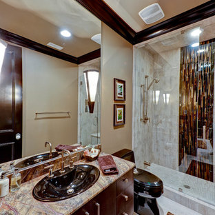 Example of a trendy bathroom design in Charlotte with dark wood cabinets and multicolored countertops