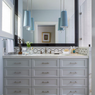 Trendy bathroom photo in San Francisco with gray cabinets and white countertops