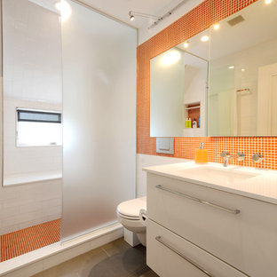Inspiration for a contemporary orange tile and mosaic tile slate floor alcove shower remodel in New York with an undermount sink, flat-panel cabinets and white cabinets