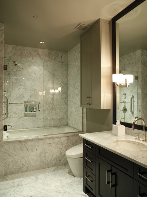 trendy marble tile bathroom photo in austin with marble countertops