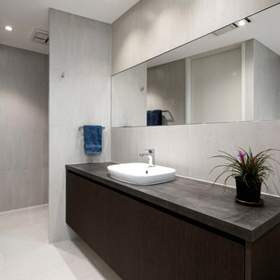 Photo of a contemporary bathroom in Perth with flat-panel cabinets, dark wood cabinets, an open shower, gray tile, a vessel sink, beige floor, an open shower and grey benchtops.