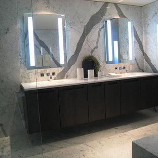 Example of a trendy bathroom design in Vancouver with an undermount sink and flat-panel cabinets