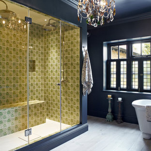 Inspiration for a contemporary bathroom in London with a freestanding bath, a double shower, multi-coloured tiles, blue walls and light hardwood flooring.