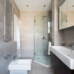 Inspiration for a mid-sized contemporary beige tile corner shower remodel in London with a trough sink, flat-panel cabinets, dark wood cabinets and a bidet