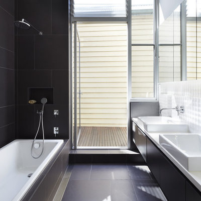 Example of a trendy 3/4 black tile and white tile black floor bathroom design in Melbourne with flat-panel cabinets, black cabinets and a console sink