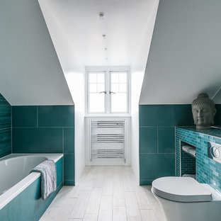 Inspiration for a transitional master drop-in bathtub remodel in London with open cabinets, a wall-mount toilet, white walls and an undermount sink