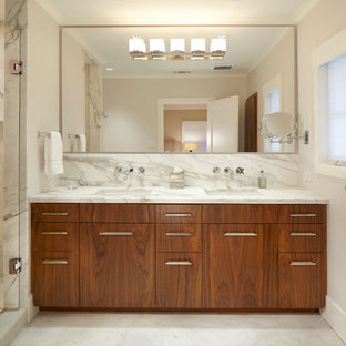 Trendy white tile and marble tile alcove shower photo in Dallas with an undermount sink, flat-panel cabinets, medium tone wood cabinets and marble countertops