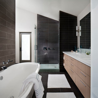 Example of a trendy brown tile bathroom design in San Diego with flat-panel cabinets and light wood cabinets