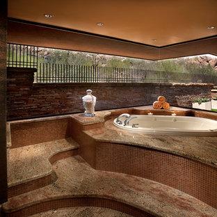 Example of a trendy master brown tile drop-in bathtub design in Phoenix