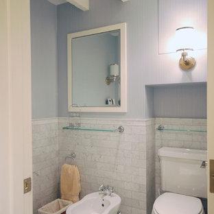 Immagine di una stanza da bagno minimal con bidè e piastrelle diamantate