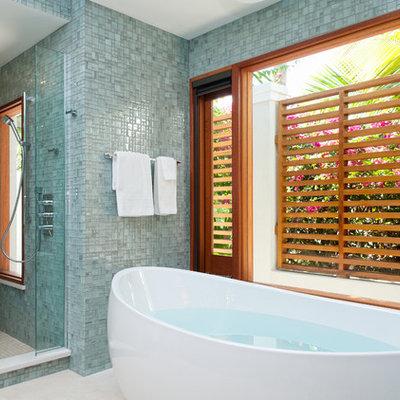 Example of a trendy mosaic tile freestanding bathtub design in Denver