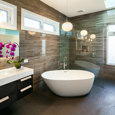 Trendy brown tile and porcelain tile bathroom photo in San Francisco with an undermount sink, flat-panel cabinets, dark wood cabinets and white countertops