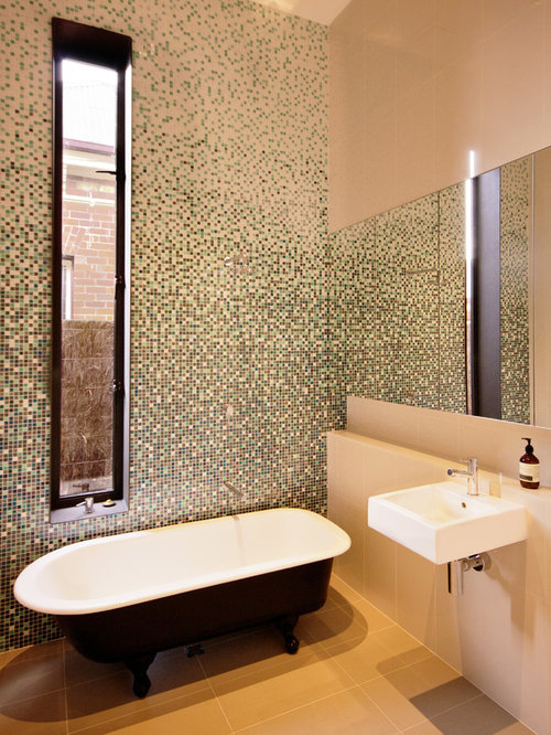 Inspiration for a contemporary mosaic tile claw-foot bathtub remodel in  Melbourne with a wall