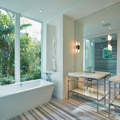 Inspiration for a large contemporary master bathroom remodel in Miami with a console sink