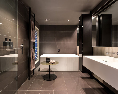 Inspiration For A Large Contemporary Master Bathroom In Melbourne With  Black Cabinets, A Freestanding Tub