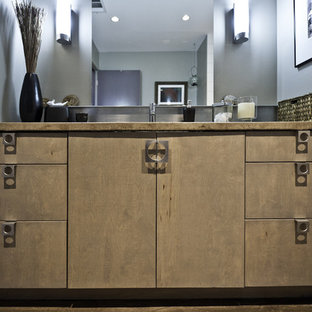 Trendy bathroom photo in Houston with flat-panel cabinets and medium tone wood cabinets