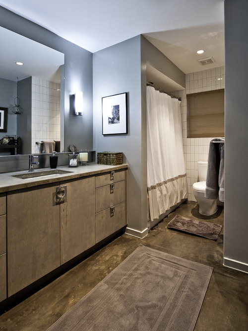 Example of a trendy tub/shower combo design in Houston with flat-panel ...