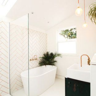 Small contemporary family bathroom in London with freestanding cabinets, green cabinets, a freestanding bath, a walk-in shower, a wall mounted toilet, white tiles, metro tiles, white walls, vinyl flooring, a console sink, wooden worktops, white floors and an open shower.
